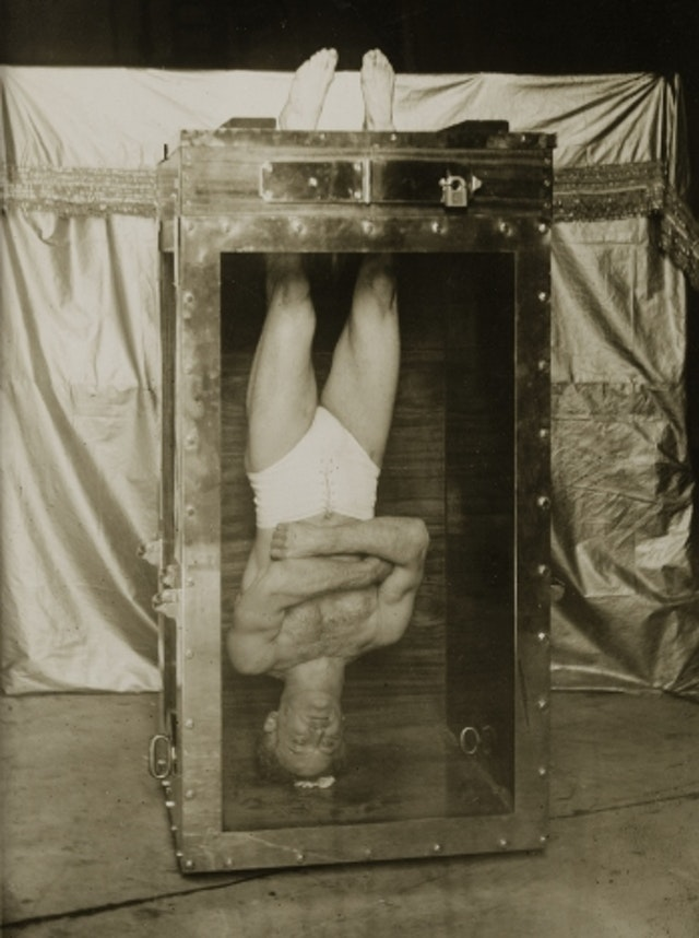 Houdini on his Water Torture Cell (1914)