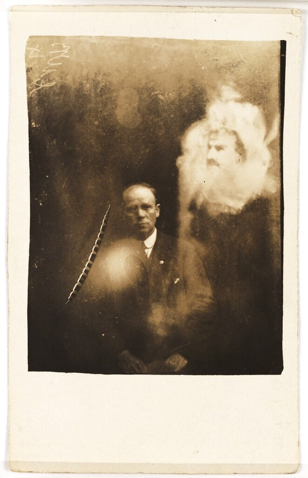 A clergyman and two spirits