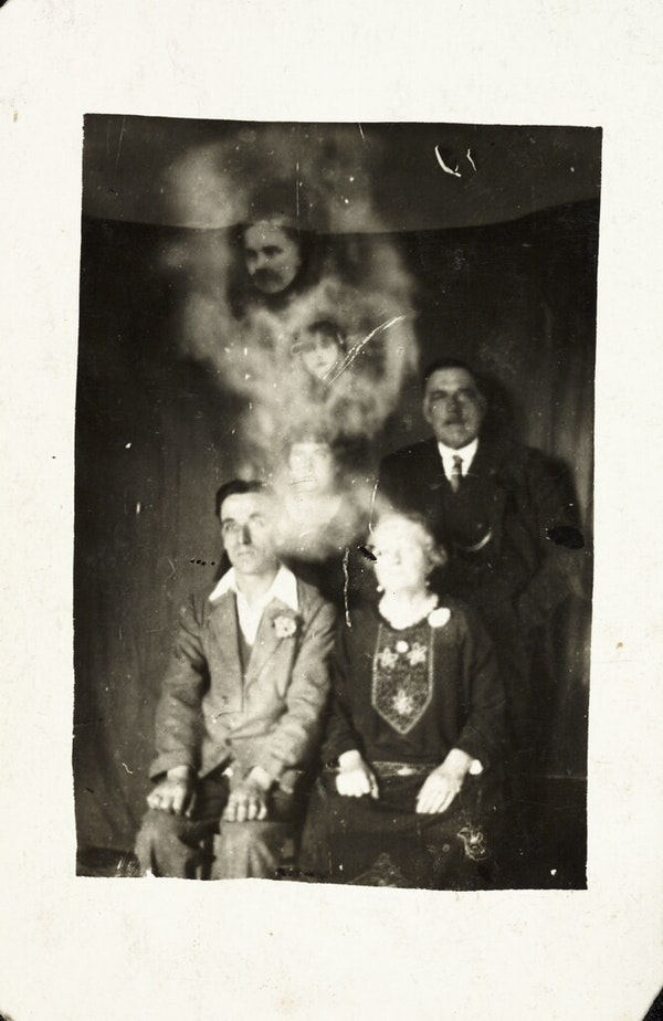 Family group with two spirits
