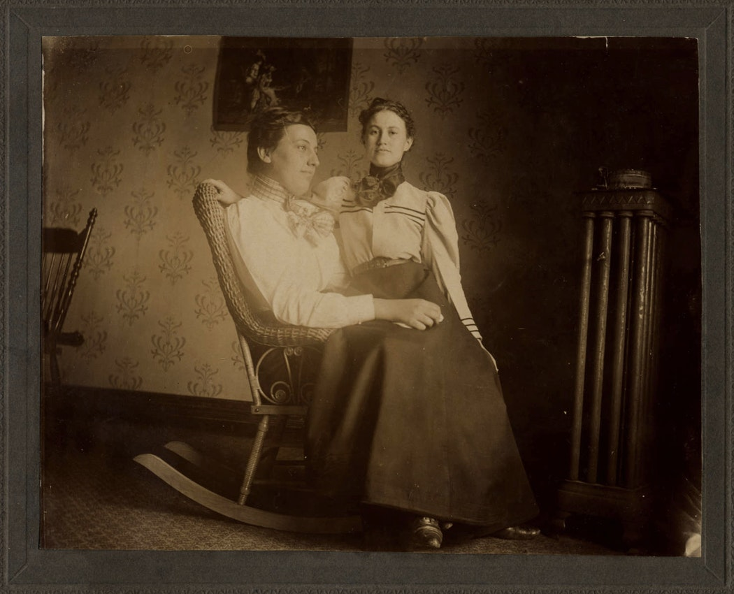 two women on a rocking chair