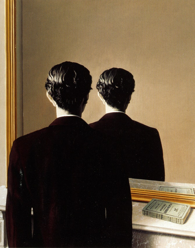 A man's back is to the viewer with a copy of Pym on a shelf and the same image is reproduced in a mirror