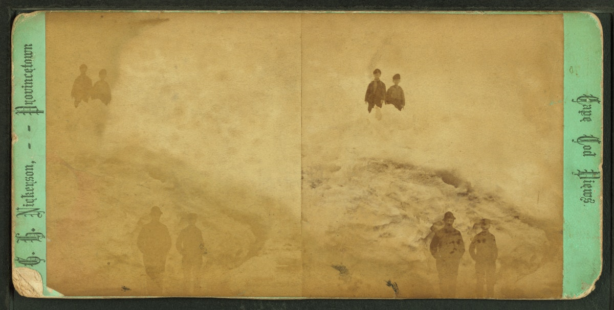 A stereo image of two people in the foreground and two in the background partially obscured by ice