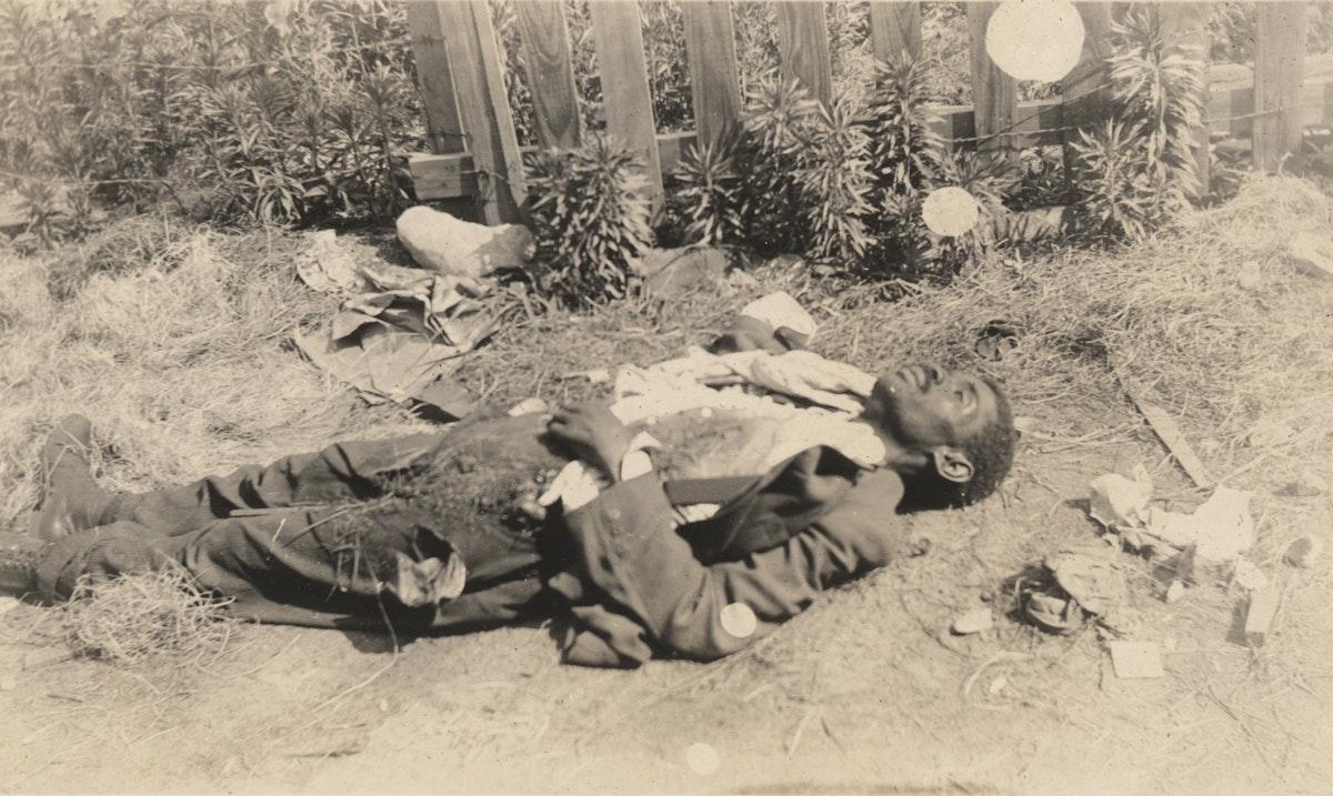Dead Black man lying face-up on ground, tulsa massacre