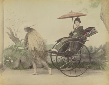 Woman with Parasol being Pulled in a Jinrikisha