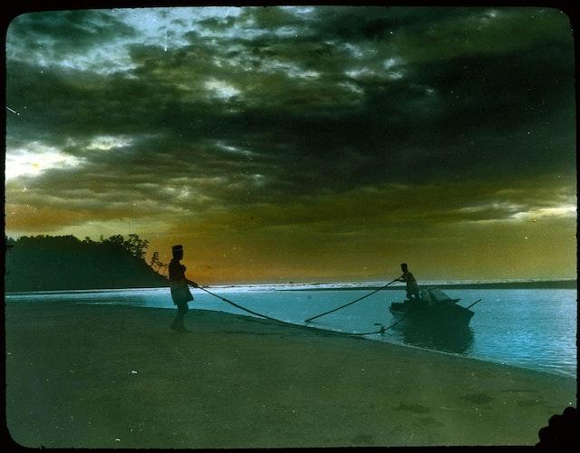 Two Men Landing Boat on Beach
